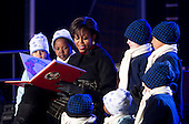 """United States First Lady Michelle Obama reads """"'Twas the Night Before Christmas"""" to children during the National Christmas Tree lighting ceremony on the Ellipse near the White House in Washington, DC, on Thursday, December 9, 2010. The first Christmas tree lighting ceremony took place back in 1923, with U.S. President Calvin Coolidge presiding. .Credit: Andrew Harrer / Pool via CNP"""