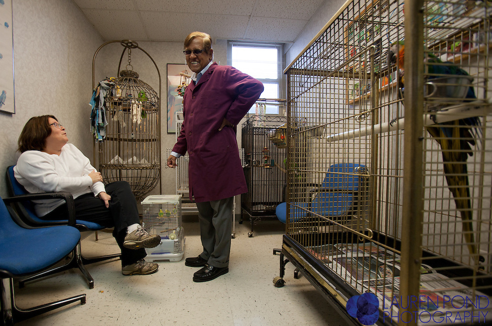 Dr. Ram Mohan meets with client Colleen Crooks, of Chillicothe, Ohio, in the waiting room at the Avian Health Clinic in Reynoldsburg, Ohio. Crooks had brought her two parakeets for a check-up.