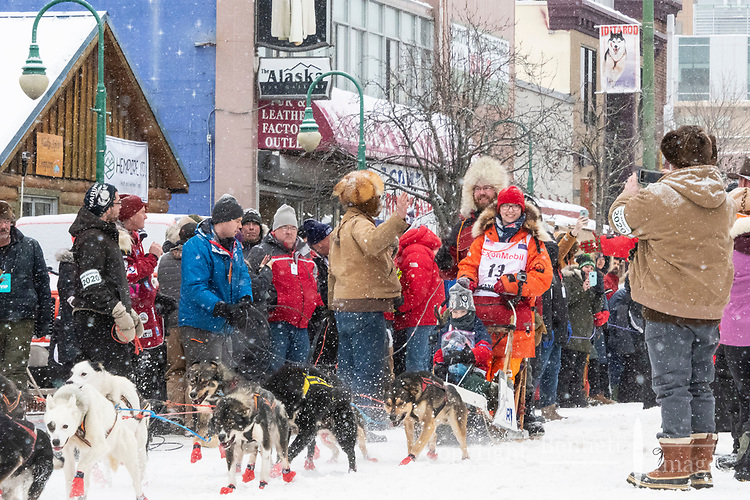 Meredith Mapes and team leave the ceremonial start line with an Iditarider and handler at 4th Avenue and D street in downtown Anchorage, Alaska on Saturday March 7th during the 2020 Iditarod race. Photo copyright by Cathy Hart Photography.com