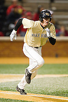 Kevin Conway (8) of the Wake Forest Demon Deacons hustles down the first base line against the North Carolina State Wolfpack at Wake Forest Baseball Park on March 15, 2013 in Winston-Salem, North Carolina.  The Wolfpack defeated the Demon Deacons 12-6.  (Brian Westerholt/Four Seam Images)