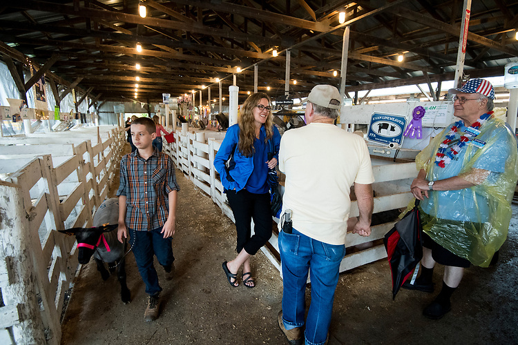 UNITED STATES - AUGUST 3: Jennifer Wexton, the Democrat running for Virginia's 10th Congressional district seat, talks with supporters in one of the livestock barn at the Frederick County Fair in Clear Brook, Va., on Friday, Aug. 3, 2018. (Photo By Bill Clark/CQ Roll Call)