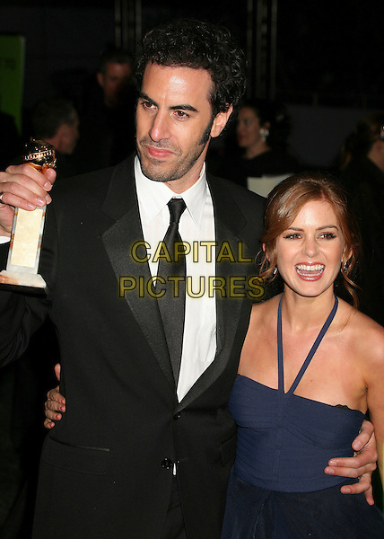 SACHA BARON COHEN & ISLA FISHER.Best Performance by an Actor in a Motion Picture - Musical or Comedy .Paramount - DreamWorks Official Golden Globes After Party at The Beverly Hilton Hotel, Beverly Hills, California, USA..January 15t, 2007.half length black suit jacket blue halterneck couple Sasha award trophy.CAP/ADM/BP.©Byron Purvis/AdMedia/Capital Pictures