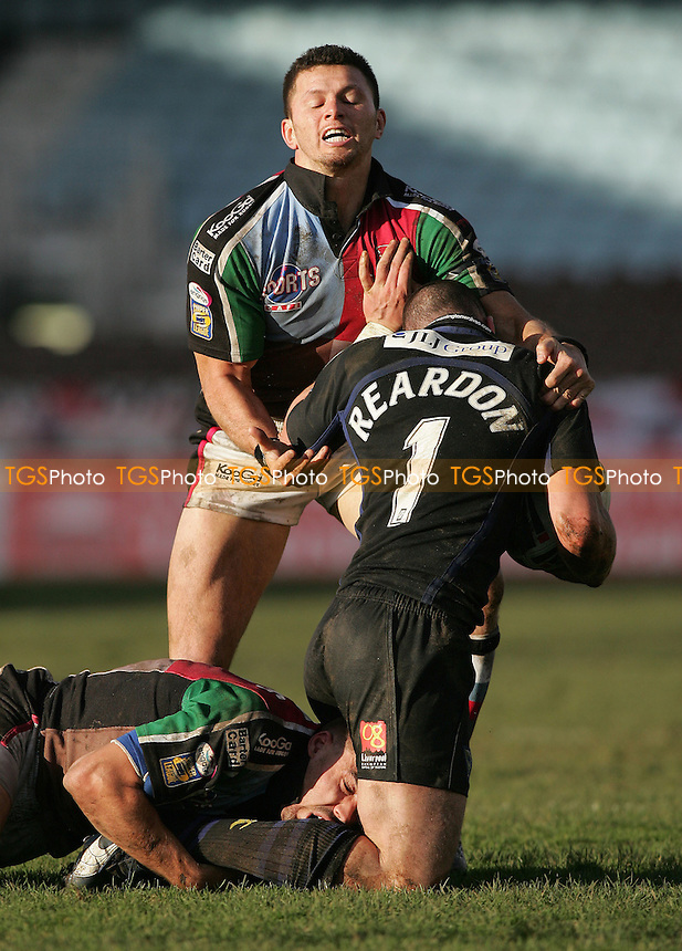 Stuart Reardon of Warrington is tackled by Harlequins duo Henry Paul and Chris Melling - Harlequins RL vs Warrington RL - Rugby League at The Stoop, Twickenham - 03/03/07 - MANDATORY CREDIT: Rob Newell/TGSPHOTO