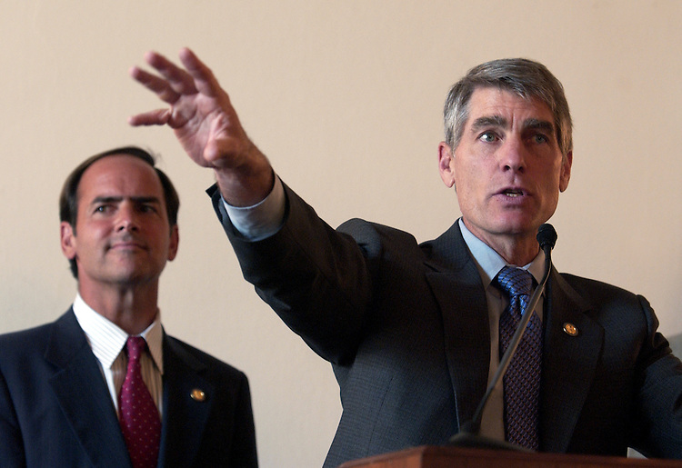 Reps. Mark Udall, D-Colo., speaking, and Zach Wamp, R-Tenn., attend the Eighth Annual Congressional Renewable Energy and Energy Efficiency Forum and Expo.