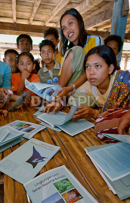 Women study conservation booklets, Papagaran island, Komodo National Park