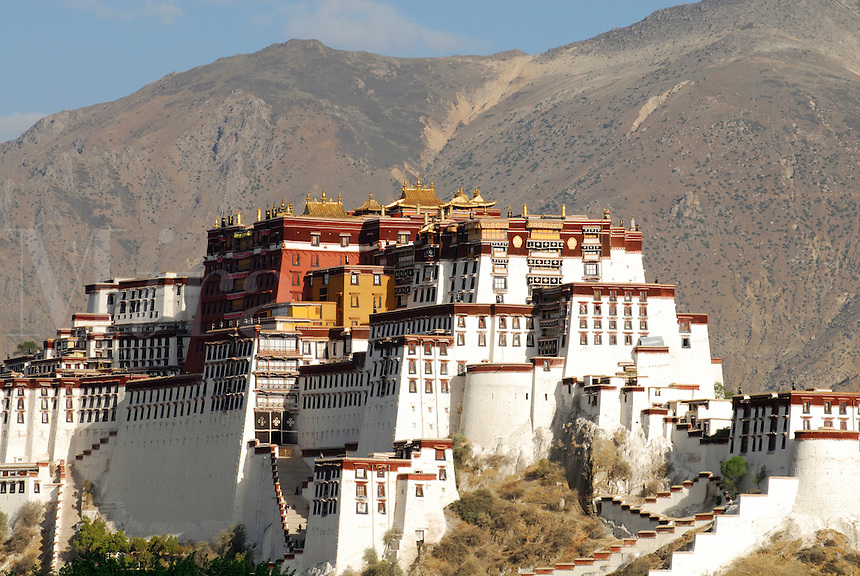 On the original site of King Songtsen Gampo's palace in the 7th century, the Potala is composed of White Palace completed in 1653 by the fifth Dalai Lama and Red Palace in 1694.  Past residence of Dalai Lamas, seat of Tibetan government, on the UNESCO World Heritage List, now empty, the Palace sits atop Marpo Ri, Red Hill, and overlooks Lhasa, Tibet, China.