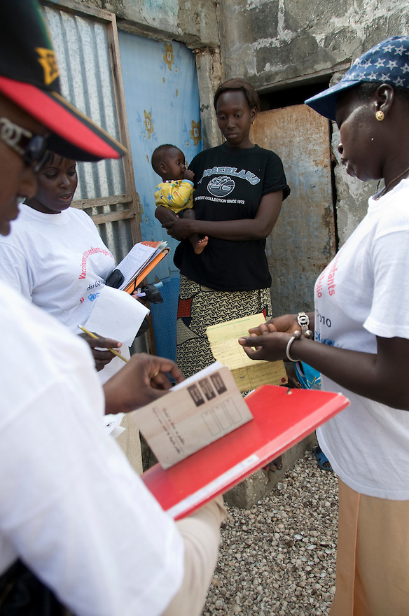 Joal, Sengal - Health workers in Joal, Senegal goes door to door to vaccinate children for polio. Senegal is taking part in the Joint Global Polio Eradication Initiative- a regional effort to eradicate polio and vaccinate children in West and Central Africa...