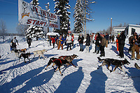 Crossing the finish line in first place is Cain Carter at the end of  the 2009 Junior Iditarod in Willow, Alaska.   Cain is the step-son of current Iditarod champion Lance Mackey and is running Lance's Iditarod team.  March 1, 2009