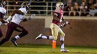 TALLAHASSEE, FLA. 9/5/15-Florida State University quarterback Everett Golson scrambles away from Texas State University defenders during first half action at Doak Campbell Stadium in Tallahassee.<br /> <br /> COLIN HACKLEY PHOTO