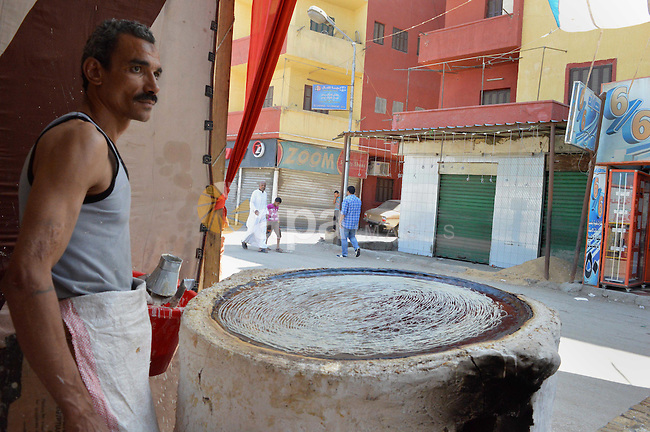 "An Egyptian man prepares a traditional sweets ""Konafa"" on the holy month of Ramadan, in Cairo, Egypt, on June 12, 2016. Ramadan is sacred to Muslims because it is during that month that tradition says the Koran was revealed to the Prophet Mohammed. The fast is one of the five main religious obligations under Islam. More than 1.5 billion Muslims around the world will mark the month, during which believers abstain from eating, drinking, smoking and having sex from dawn until sunset. Photo by Amr Sayed"