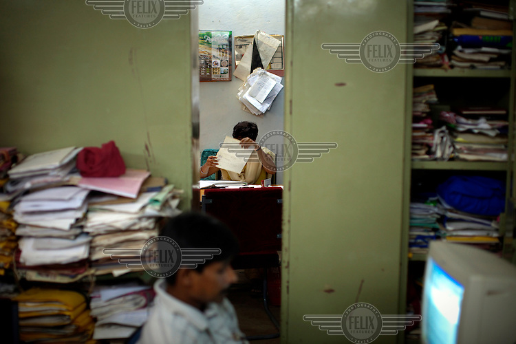 Stacks of documents are seen inside the Superintendent of Police's (S.P.) office in Dantewada. S.P. Amresh Mishra claims to have information on all of the Naxal (Maoist) insurgents operating in his area, if not their photographs. /Felix Features