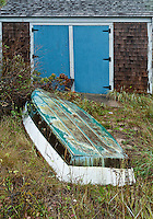 Resting rowboat and boathouse, Cape Cod, Massachusetts, USA