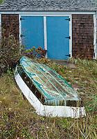 Resting rowboat and boathouse, Cape Cod, Massachusetts, USA