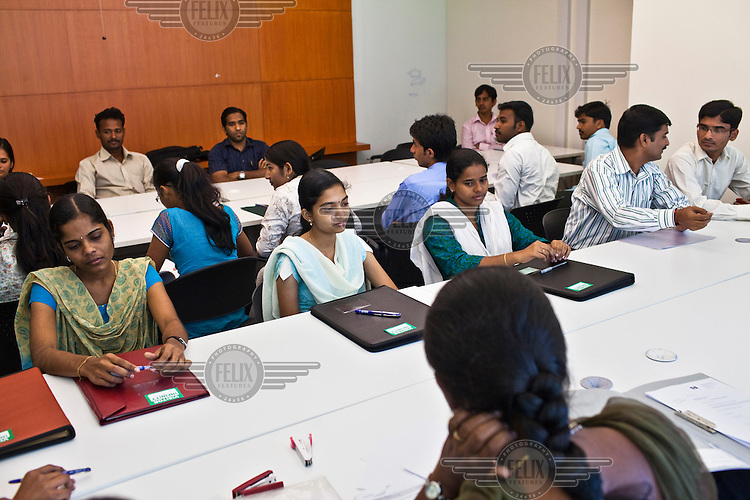 Job interview candidates wait for their turn at the Ernst & Young Global Shared Services office in Bangalore.