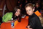 Kameron poses with Nicole Bocchi (Mary Poppins & How Grinch Stole Christmas), New York City, New York. Photo taken at Kids Night on Broadway at Madame Tussauds, NYC. (Photo by Sue Coflin/Max Photos)