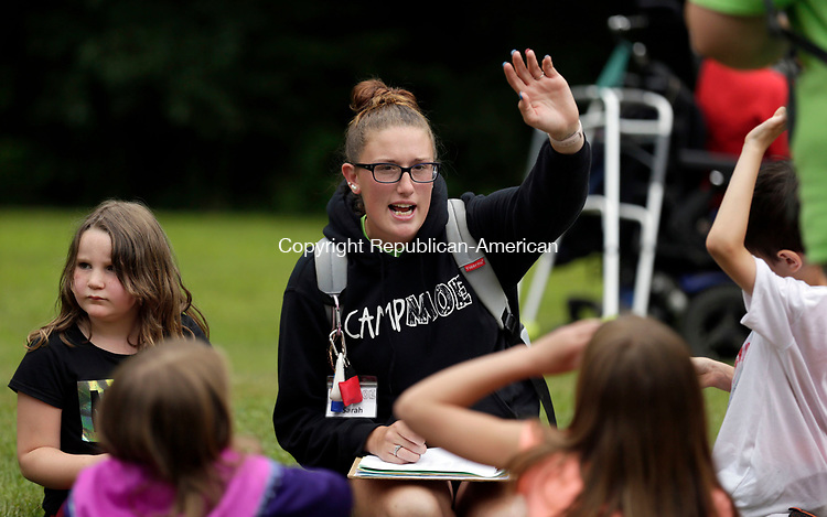"Torrington, CT- 27 July 2017-072717CM01-   Camp counselor Sarah Dubourg gets her campers ready for the annual Camp Moe Carnival in Torrington on Thursday.  The annual carnival honors Emil ""Moe"" Renzullo, a camper, who passed away in 2010 after a long battle with Leukemia.       Christopher Massa Republican-American"