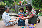 Berkeley CA Mixed race couple, white and African American playing with their five-year-old son  MR