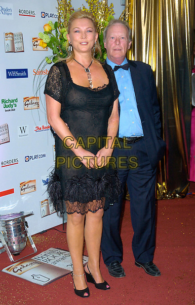 AMANDA REDMAN & DENNIS WATERMAN .The Galaxy British Book Awards, Grosvenor House Hotel, London, England. .March 28th, 2007.full length blue suit black dress crochet sleeves lace feathers .CAP/CAN.©Can Nguyen/Capital Pictures