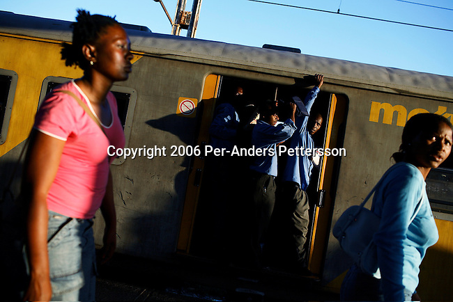SOWETO, SOUTH AFRICA OCTOBER 24: Commuters fight for space on a train from downtown Johannesburg October 24, 2006 in the Orlando West section of Soweto, Johannesburg, South Africa. Soweto is South Africa?s largest township and it was founded about one hundred years to make housing available for black people south west of downtown Johannesburg. The estimated population is between 2-3 million. Many key events during the Apartheid struggle unfolded here, and the most known is the student uprisings in June 1976, where thousands of students took to the streets to protest after being forced to study the Afrikaans language at school. Soweto today is a mix of old housing and newly constructed townhouses. A new hungry black middle-class is growing steadily. Many residents work in Johannesburg but the last years many shopping malls have been built, and people are starting to spend their money in Soweto.  .(Photo by Per-Anders Pettersson/Getty Images).