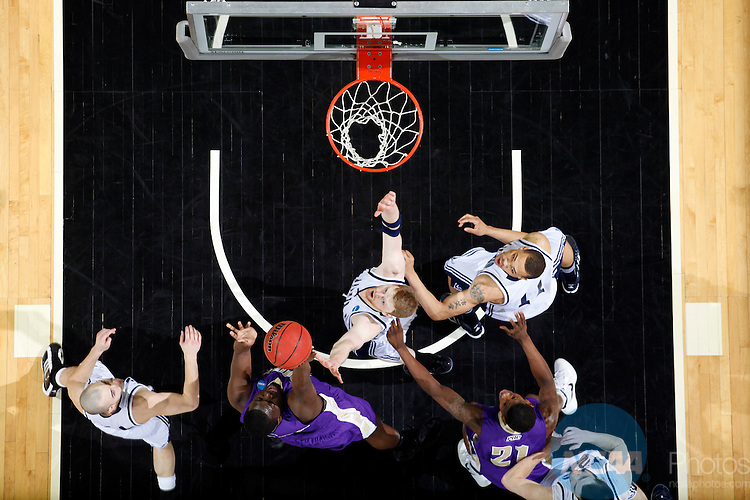 24 MAR 2012:  Drico Hightower (32) of the University of Montevallo puts up a shot against Western Washington University during the Division II Men's Basketball Championship held at the Bank of Kentucky Center in Highland Heights, KY.  Western Washington defeated Montevallo 72-65 for the national title.  Joe Robbins/NCAA Photos