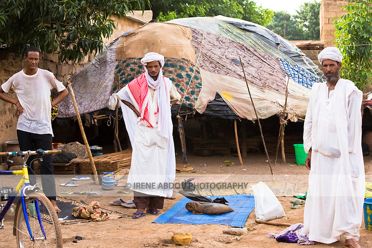 Traditionally nomadic pastoralists, a Touareg family in Ouagadougou, Burkina Faso, lives under makeshift tents patched together from pieces of cloth.
