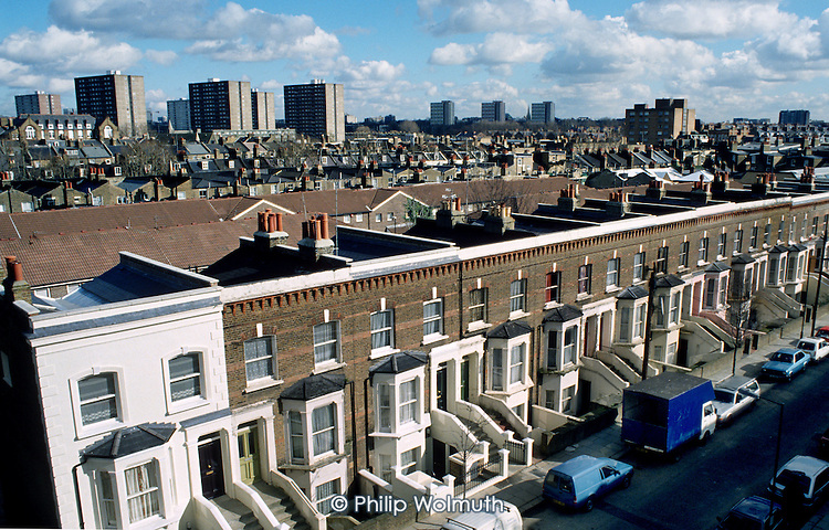 Aerial view over Victorian terraced housing on resident-controlled Walterton Estate in Paddington, London and, in the distance, the high-rise blocks of South Kilburn Estate.