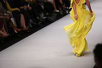 A model wears a yellow dress creation by Mexican designer Alejandro Carlin, during the Mercedes Benz Fashion Week Mexico Spring/Summer 2015, in Mexico City, 10.01.2014. VIEWpress / Miguel Angel Pantaleon