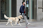 A man walks his dog through the streets of Madrid during the first day of permission so that the children can spend an hour daily on the street during the health crisis due to the Covid-19 virus pandemic - Coronaviruss. April 26,2020. (ALTERPHOTOS/Alejandro de Dios)