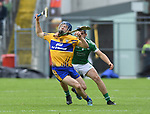 Shane O'Donnell of Clare in action against Mike Casey of Limerick during their Munster Championship semi-final at Thurles.  Photograph by John Kelly.