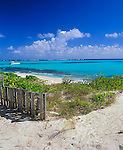 Anguilla; BWI<br /> Weathered fence on the beach dunes and turquoise waters of Upper Shoal Bay, Caribbean Sea