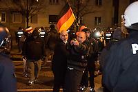 """Ca. 90 Hooligans und Nazis beteiligten sich am Montag den 1. Februar 2016 im Berliner Stadtteil Prenzlauer Berg an einer NPD-Demonstration gegen Asyl und Fluechtlinge. Die aggressive Demonstration wurde von lautstarken Protesten mehrerer hundert Gegendemonstranten begleitet. Die Demonstrationsroute wurde auf Anweisung der Polizei um 2/3 gekuerzt.<br /> Im Bild links: Enrico Schottstaedt, Anhaenger des Fussballclub Union Berlin und Organisator der Gruppierung """"Buendnis deutscher Hools"""" (B.D.H.) versucht einen alkoholisierten Demonstranten davon abzuhalten Gegendemonstranten anzugreifen.<br /> 1.2.2016, Berlin<br /> Copyright: Christian-Ditsch.de<br /> [Inhaltsveraendernde Manipulation des Fotos nur nach ausdruecklicher Genehmigung des Fotografen. Vereinbarungen ueber Abtretung von Persoenlichkeitsrechten/Model Release der abgebildeten Person/Personen liegen nicht vor. NO MODEL RELEASE! Nur fuer Redaktionelle Zwecke. Don't publish without copyright Christian-Ditsch.de, Veroeffentlichung nur mit Fotografennennung, sowie gegen Honorar, MwSt. und Beleg. Konto: I N G - D i B a, IBAN DE58500105175400192269, BIC INGDDEFFXXX, Kontakt: post@christian-ditsch.de<br /> Bei der Bearbeitung der Dateiinformationen darf die Urheberkennzeichnung in den EXIF- und  IPTC-Daten nicht entfernt werden, diese sind in digitalen Medien nach §95c UrhG rechtlich geschuetzt. Der Urhebervermerk wird gemaess §13 UrhG verlangt.]"""