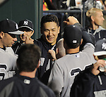 Masahiro Tanaka (Yankees),<br /> MAY 14, 2014 - MLB :<br /> Masahiro Tanaka of the New York Yankees is congratulated by his teammates back in the dugout after his first MLB hit in the ninth inning during the Major League Baseball game against the New York Mets at Citi Field in Flushing, New York, United States. (Photo by AFLO)