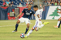 FOXBOROUGH, MA - JULY 27: Dom Dwyer #14 takes a shot at goal at Gillette Stadium on July 27, 2019 in Foxborough, Massachusetts.