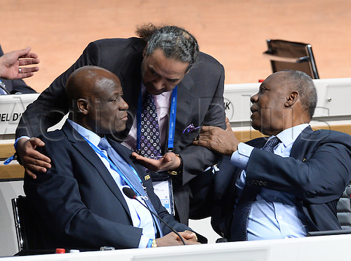 26.02.2016. Zurich, Switzerland.  FIFA Executive Committee Members Constant OImari (L-R), Sheikh Ahmad al Fahad al Sabah and acting FIFA president Issa Hayatou talk during the Extraordinary FIFA Congress 2016 at the Hallenstadion in Zurich, Switzerland, 26 February 2016. The Extraordinary FIFA Congress is being held in order to vote on the proposals for amendments to the FIFA Statutes and choose the new FIFA President.