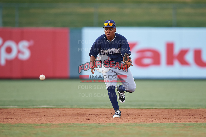 Shortstop Bryan Torres (12), of the AZL Padres 1, fields a ground ball during an Arizona League game against the AZL Angels on August 5, 2019 at Tempe Diablo Stadium in Tempe, Arizona. AZL Padres 1 defeated the AZL Angels 5-0. (Zachary Lucy/Four Seam Images)