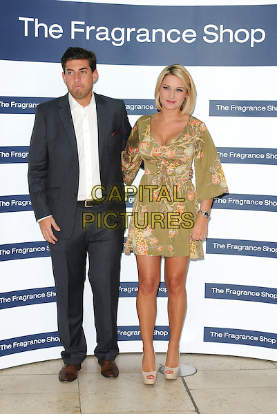 "James ""Arg"" Argent & Sam Faiers.Make An Appearance To Promote Their Fragrances ""Be Reem"" And ""Dazzle"" At The Fragrance Shop, Bluewater Shopping Centre, Greenhithe, Kent, UK 31st March 2012..perfume launch photocall TOWIE full length suit green floral print khaki dress  white shirt grey gray .CAP/BRC.©Ben Rector/Capital Pictures."