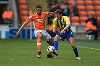 Accrington Stanley's Jordan Clark is tackled by Blackpool's Colin Daniel<br /> <br /> Photographer Terry Donnelly/CameraSport<br /> <br /> The EFL Sky Bet League Two - Blackpool v Accrington Stanley - Friday 14th April 2017 - Bloomfield Road - Blackpool<br /> <br /> World Copyright &copy; 2017 CameraSport. All rights reserved. 43 Linden Ave. Countesthorpe. Leicester. England. LE8 5PG - Tel: +44 (0) 116 277 4147 - admin@camerasport.com - www.camerasport.com