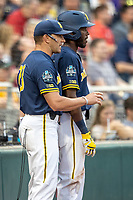 Michigan Wolverines outfielder Christian Bullock (5) talks with head coach Erik Bakich (23) during Game 6 of the NCAA College World Series against the Florida State Seminoles on June 17, 2019 at TD Ameritrade Park in Omaha, Nebraska. Michigan defeated Florida State 2-0. (Andrew Woolley/Four Seam Images)