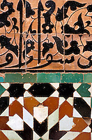 Intricate mosaics on a wall, Ben Youssef Madrasa, Marrakech, Morocco.