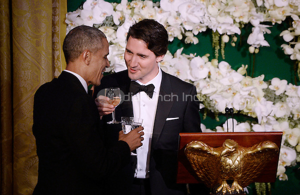 United States President Barack Obama and Prime Minister Justin Trudeau of Canada exchange toasts at the state dinner honoring the Prime Minister and Mrs. Sophie Gr&Egrave;goire Trudeau at the White House March 10, 2016 in Washington, DC. <br /> Credit: Olivier Douliery / Pool via CNP/MediaPunch
