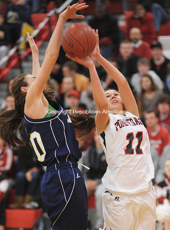 SOUTHBURY,  CT, 14 FEBRUARY  2012-021412JS07-Pomperaug's Haili Welton (11) gets her shot blocked by Lauralton Hall's Cassie Gildea (30) during their game Tuesday at Pomperaug High School in Southbury.Jim Shannon Republican-American