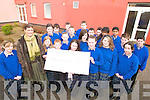 BOTHAR: Anita Schwarz of the Bothar charity receives a cheque for EUR590 for the charity from first year students at Presentation Secondary School in Milltown.