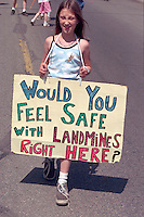 Age 12 protester for a ban on land mines. In the Heart of the Beast May Day Festival and Parade Minneapolis Minnesota USA