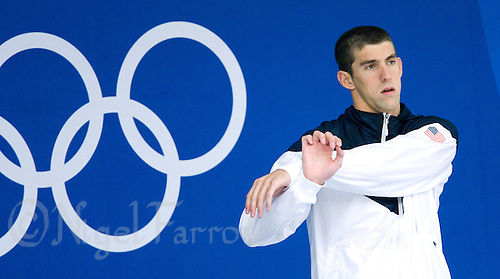 15 AUG 2008 - BEIJING, CHN - Michael Phelps (USA) stretches before the medal ceremony for the Men's 200m individual medley final which he won in a new World Record time of 1 minute 54.23 seconds -  Beijing Olympics. (PHOTO (C) NIGEL FARROW) *** IOC RULES APPLY ON USAGE ***