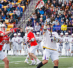 University at Albany Men's Lacrosse defeats Cornell 11-9 on Mar 4 at Casey Stadium.  Cornell defender Fleet Wallace steals a pass from Tehoka Nanticoke (#1).