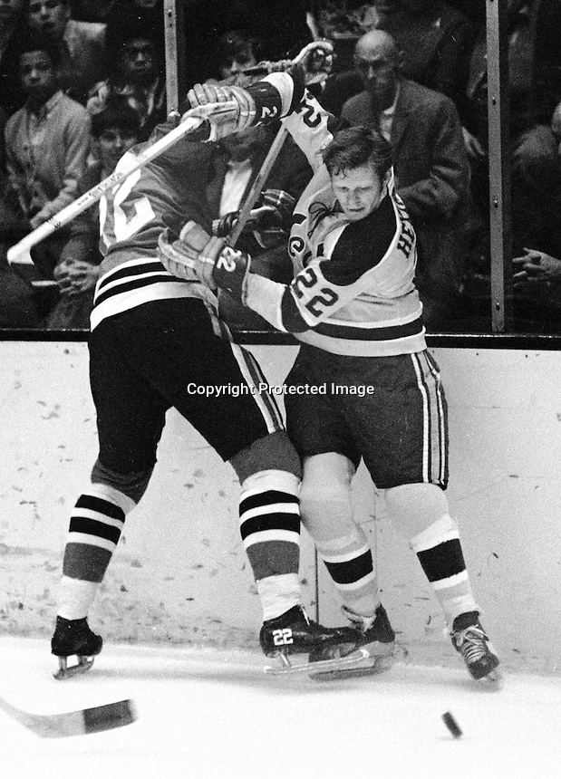 California Golden Seal Dennis Hextall mixes it up on the boards with Black Hawks Jerry Korab 1971 Photo/Ron Riesterer