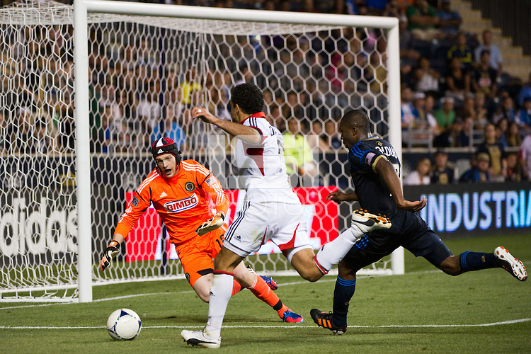 Philadelphia Union goalkeeper Zac MacMath (18) denies Dwayne De Rosario (7) of DC United. DC United defeated Philadelphia Union 1-0 during a Major League Soccer (MLS) match at PPL Park in Chester, PA, on June 16, 2012.