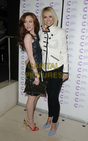 Natasha Hamilton & Liz McClarnon.James' 'Jog-on to Cancer' charity fundraiser for Cancer Research UK at the Kensington Roof Gardens, London, England..April 3rd 2013.full length black white military jacket skinny jeans denim blue shoes dress side red open toe clutch bag studs studded sparkly.CAP/CAN.©Can Nguyen/Capital Pictures.