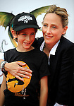UNIVERSAL CITY, CA. - March 21: Kim Raver and son Luke arrive at the premiere of ''How To Train Your Dragon'' at Gibson Amphitheater on March 21, 2010 in Universal City, California.