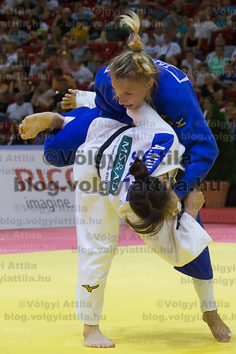Aimi Nouchi (in white) of Japan and Martyna Trajdos (in blue) of Germany fight during the Women -63 kg category at the Judo Grand Prix Budapest 2018 international judo tournament held in Budapest, Hungary on Aug. 11, 2018. ATTILA VOLGYI